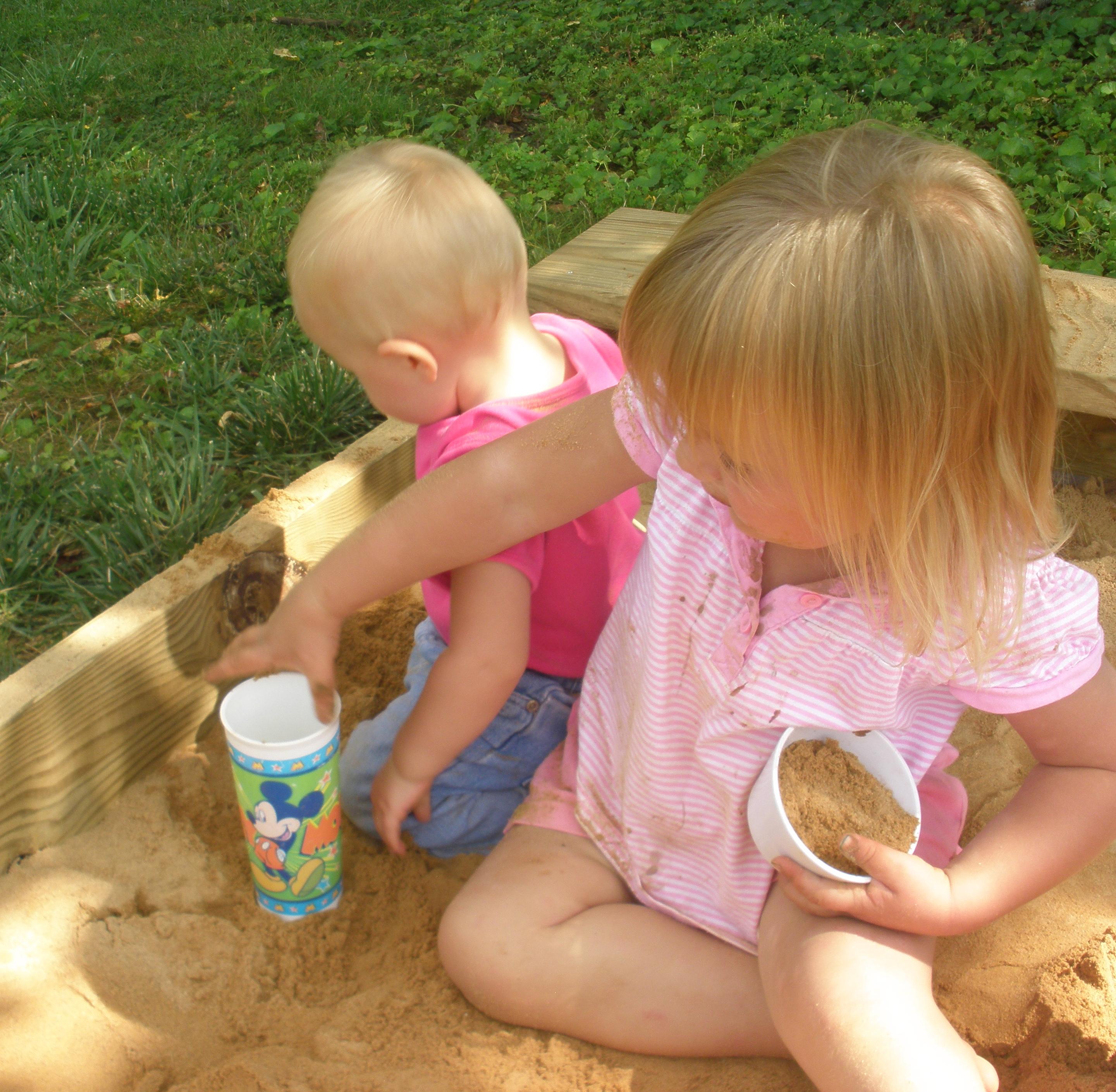 girls in a sandbox