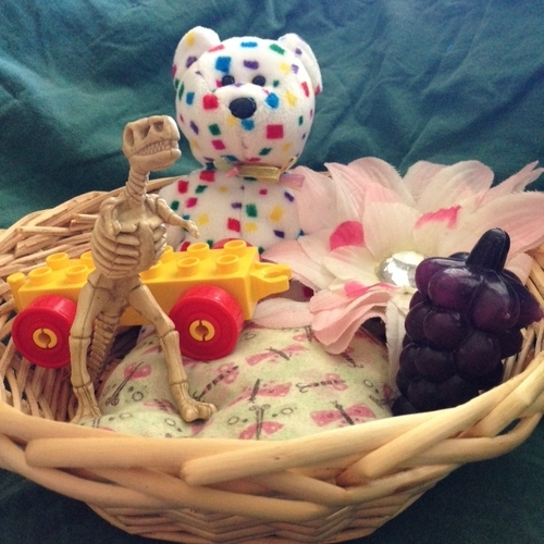 Come learn why a treasure basket is perfect for your sitting up baby at becausebabiesgrowup.com