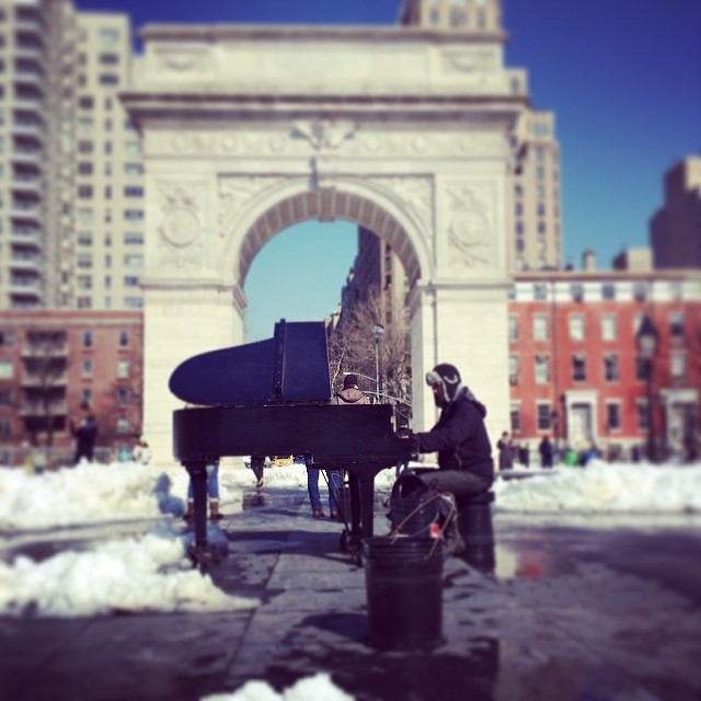 Piano player in the winter in Central Park, NYC